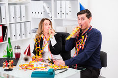 Businessman and businesswoman celebrating  together in the offic Stock Photography