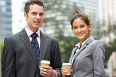 Businessman And Businesswoman Chatting In Street Stock Photos