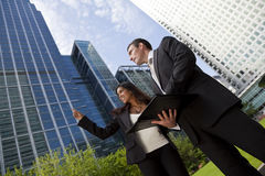 Businessman and Businesswoman In City stock image
