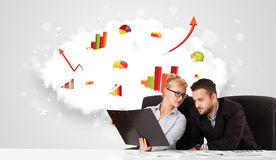 Businessman and businesswoman with cloud in the background conta Stock Photo