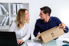 Businessman and businesswoman with delivery in the office Royalty Free Stock Photo