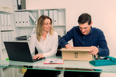 Businessman and businesswoman with delivery in the office Stock Photos