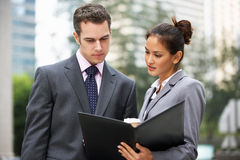 Businessman And Businesswoman Discussing Document Stock Photography