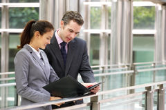 Businessman And Businesswoman Discussing Document stock photo