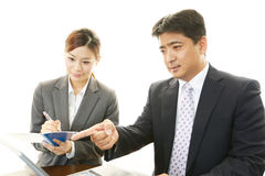 Businessman and businesswoman discussing plans Stock Photos