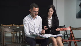 Businessman and businesswoman discussing something stock footage