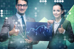 The businessman and businesswoman discussing trading strategies Stock Photography