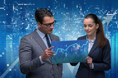The businessman and businesswoman discussing trading strategies Royalty Free Stock Photo