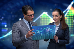 The businessman and businesswoman discussing trading strategies. Businessman and businesswoman discussing trading strategies Royalty Free Stock Images