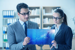 The businessman and businesswoman discussing trading strategies Royalty Free Stock Image