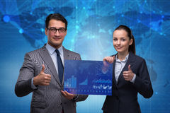 The businessman and businesswoman discussing trading strategies Stock Images
