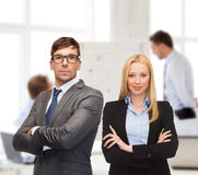 Businessman and businesswoman in the front of team royalty free stock image