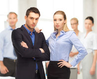 Businessman and businesswoman in the front of team Stock Photos