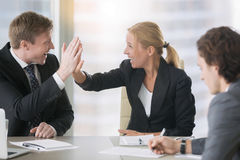 Businessman and businesswoman giving a high five Royalty Free Stock Photo