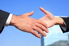 Businessman and businesswoman handshake Stock Image