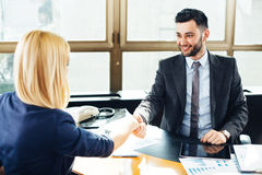 Businessman and businesswoman handshake Royalty Free Stock Image