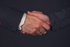 Businessman and businesswoman handshake in office Stock Photography