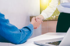 Businessman and businesswoman handshake after successful on targ Stock Images