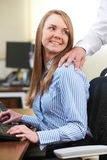 Businessman And Businesswoman Having Affair In Office Stock Photo