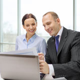 Businessman and businesswoman having discussion Stock Photo