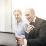 Businessman and businesswoman having discussion Stock Images