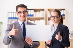 The businessman and businesswoman having discussion in office. Businessman and businesswoman having discussion in office royalty free stock image