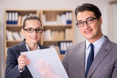 The businessman and businesswoman having discussion in office. Businessman and businesswoman having discussion in office stock photos