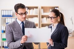 The businessman and businesswoman having discussion in office. Businessman and businesswoman having discussion in office stock image