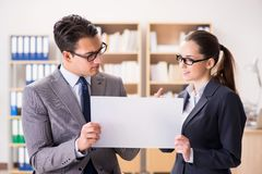 The businessman and businesswoman having discussion in office. Businessman and businesswoman having discussion in office stock images