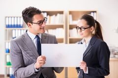 The businessman and businesswoman having discussion in office. Businessman and businesswoman having discussion in office royalty free stock images