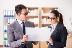 The businessman and businesswoman having discussion in office. Businessman and businesswoman having discussion in office stock photography