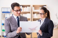 The businessman and businesswoman having discussion in office. Businessman and businesswoman having discussion in office stock photo