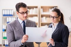 The businessman and businesswoman having discussion in office. Businessman and businesswoman having discussion in office royalty free stock photo
