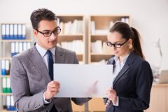 The businessman and businesswoman having discussion in office. Businessman and businesswoman having discussion in office royalty free stock photography