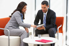 Businessman And Businesswoman Having Informal Meeting. Businessman And Businesswoman Having Informal Office Meeting Stock Photography
