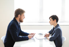 Businessman and businesswoman having interview Royalty Free Stock Image