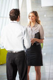 Businessman And Businesswoman Having Meeting In Office Stock Image