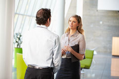 Businessman And Businesswoman Having Meeting In Office Royalty Free Stock Photo