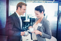Businessman and businesswoman having tea during breaktime Stock Image