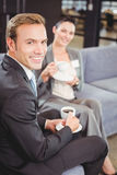 Businessman and businesswoman having tea during breaktime Royalty Free Stock Photo