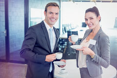 Businessman and businesswoman having tea during breaktime Stock Images