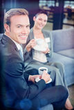 Businessman and businesswoman having tea during breaktime Royalty Free Stock Photography