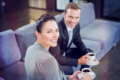 Businessman and businesswoman having tea during breaktime Stock Photography