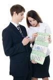 Businessman and businesswoman hold calendar Royalty Free Stock Photos