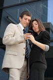 Businessman and businesswoman holding smart phone stock images