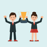 Businessman and businesswoman holding winning trophy Royalty Free Stock Images