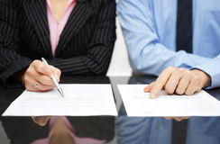 Businessman and businesswoman are inspecting  contract Royalty Free Stock Photos