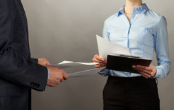 Businessman and businesswoman interchange of documents Stock Photos