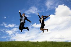 Businessman and businesswoman are jumping Stock Photos