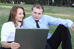 Businessman and businesswoman with laptop. At nature royalty free stock photos